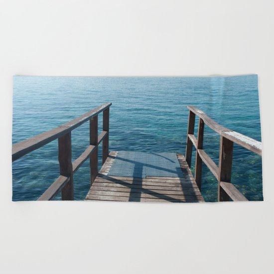 Into the sea Beach Towel