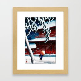 Kawase Hasui - Woman walks under an umbrella in the snow at the Zojoji red temple. Framed Art Print