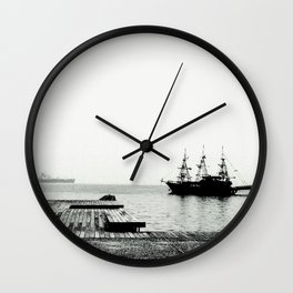 ships on a calm sea black and white Wall Clock