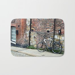 Bicycle Against Red Brick Wall Bath Mat