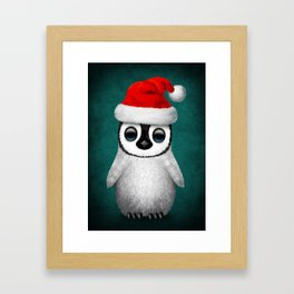 Baby Penguin Wearing a Santa Hat on Blue Framed Art Print