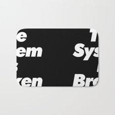 The System Is Broken Bath Mat