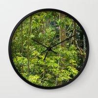 jungle Wall Clocks featuring Jungle by Mauricio Santana
