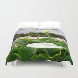 Three Cream Calla Lilies With Garden Background Duvet Cover