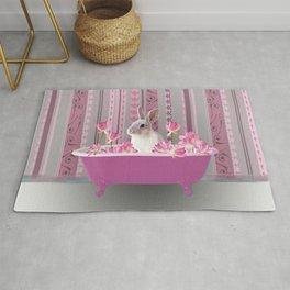 Bunny sitting in bathtub with lotus flowers #society6 Rug