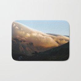 Crowned in clouds Bath Mat