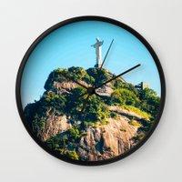 christ Wall Clocks featuring Christ Redeemer by Edgard Mello
