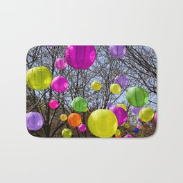 Colorful Lanterns Swinging In The Trees Bath Mat