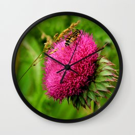 The thistle and a fly Wall Clock