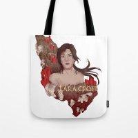 lara croft Tote Bags featuring Lara Croft by Natalie Lucht