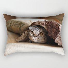 Cute kitten looking from sofa Rectangular Pillow