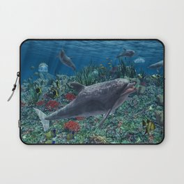 Dolphins play in the reef Laptop Sleeve