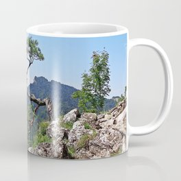 Tree in the mountain peack with green view in the sunny noon with clear blue sky Coffee Mug