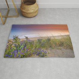 """""""Purple flowers at the sea sunset"""" Rug"""