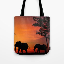 Elephants in the African sunset Tote Bag