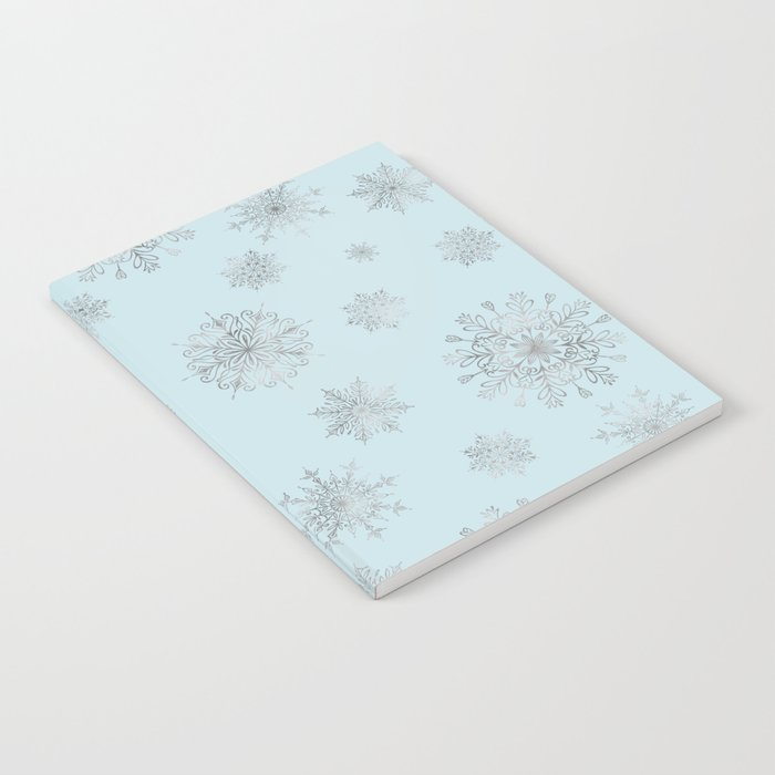 Assorted Silver Snowflakes On Light Blue Background Notebook