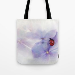 Ldybird on purple hydrangea Tote Bag