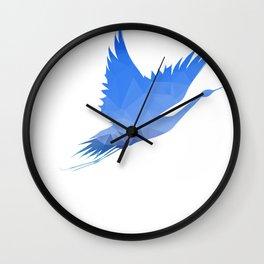 Hand holding flying bird. Vector illustration. Wall Clock