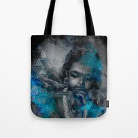 hindu Tote Bags featuring Krishna The mischievous one - The Hindu God by sarvesh