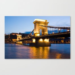 The Chain Bridge in Budapest lit by the street lights Canvas Print