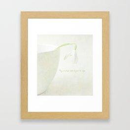 Tiny Snowdrop awakened from its sleep Framed Art Print