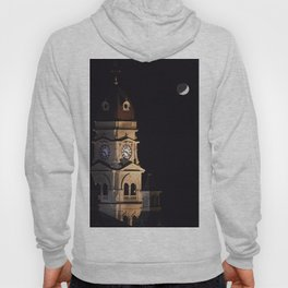 Crescent moon and earth shine at city hall clock tower Hoody