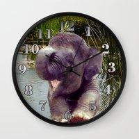 baby elephant Wall Clocks featuring Baby Elephant by Erika Kaisersot