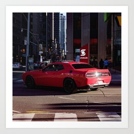 Red car roaring in downtown Toronto streets Art Print