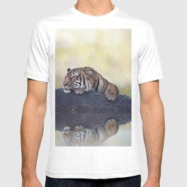 Bengal tiger resting on a rock near pond T-shirt