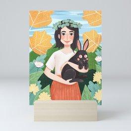 The girl and the rabbit Mini Art Print
