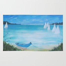 White sails & blue boat moored Rug