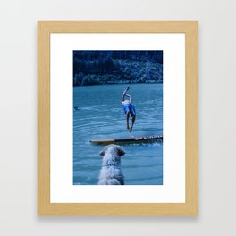 Dog watches master jump in water (Summertime reflections) Framed Art Print