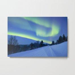 Aurora borealis over a road through winter landscape, Finnish Lapland Metal Print