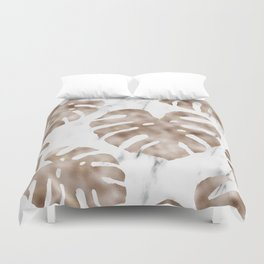 Rose gold monstera on white marble Duvet Cover