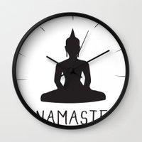 namaste Wall Clocks featuring NAMASTE by MantiniDesign