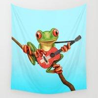 switzerland Wall Tapestries featuring Tree Frog Playing Acoustic Guitar with Flag of Switzerland by Jeff Bartels