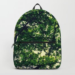 In the woods the light through leaves Backpack
