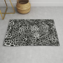 Knuckle dusters Rug