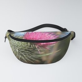 Beautiful pink thistle growing wild Fanny Pack