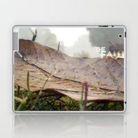 Dew drops on a fallen leaf Laptop & iPad Skin