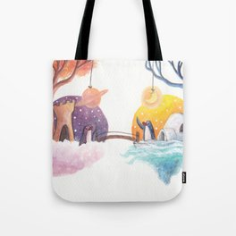 Penguins and their Bridge Between Sky Castle and Igloo with Ocean Tote Bag