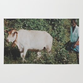 Man and cow  Rug