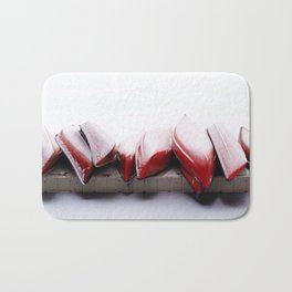 Snowfall on Red Canoes in Jasper National Park Bath Mat