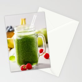 Close-up of green fresh smoothie with fruits, berries, oats and seeds, selective focus. Stationery Cards