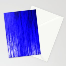 Bright texture of shiny foil of blue flowing waves on a dark fabric. Stationery Cards