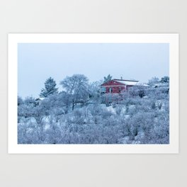 Red house lost in a snowy storm Art Print