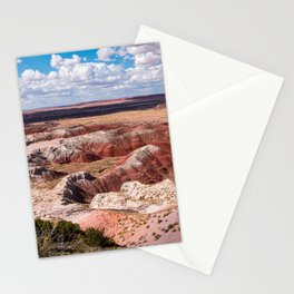 A patch of blue sky breaks through among the buttes and hills of the Painted Desert National Park Stationery Cards