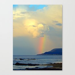 Storm Drops a Rainbow onto Village Canvas Print