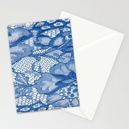 Blue lace fabric on a white background. Fancy African tulle lace fabric polyester with full length flowers for your design. The texture. Background. Pattern Stationery Cards