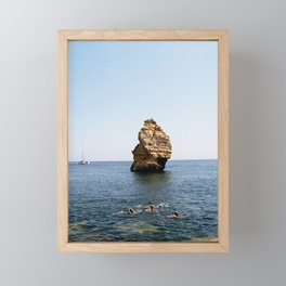 Rock and swimmers Framed Mini Art Print